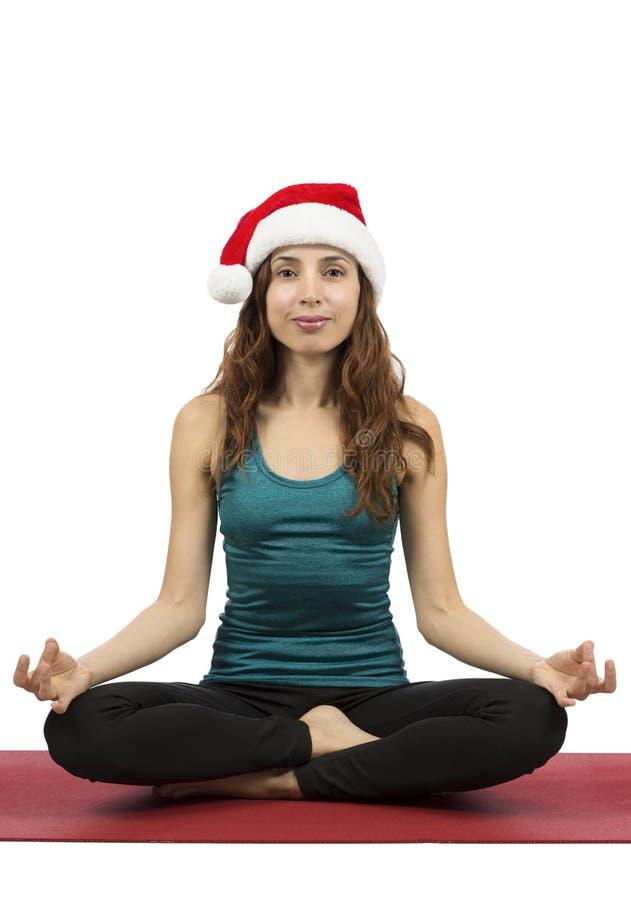Meditare della donna di Natale immagini stock