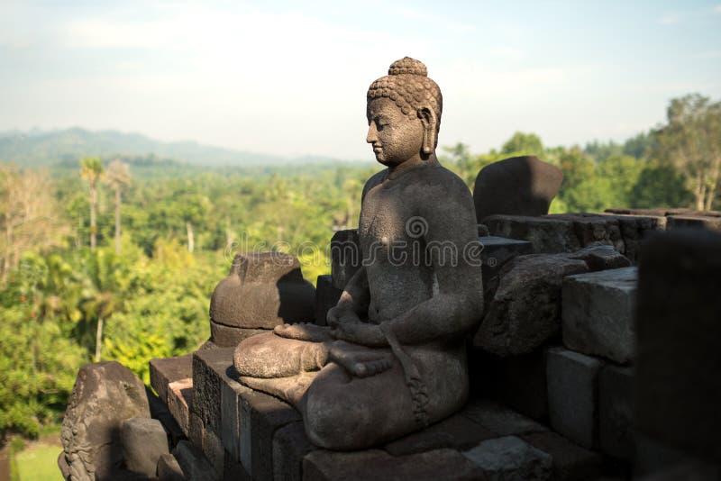 Meditare il complesso di Buddha Borobudur immagini stock libere da diritti