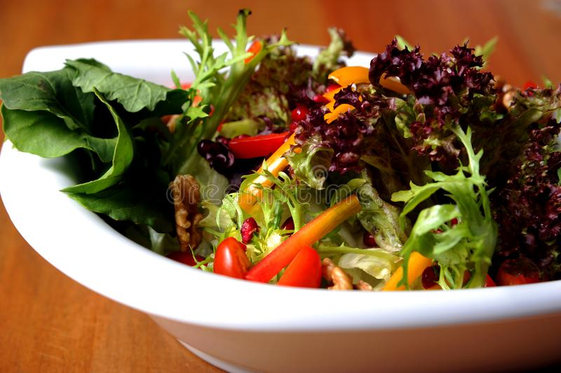 Mediterranean green salad in plate royalty free stock images