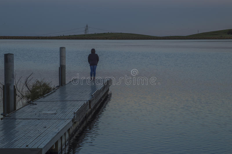 Meditating at Bethany Reservoir. San Joaquin Valley, CA. USA royalty free stock image