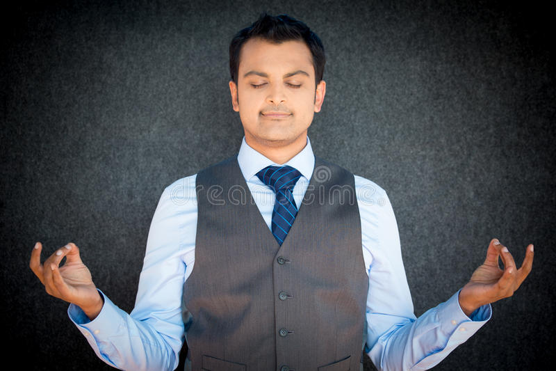 Meditating business man royalty free stock image