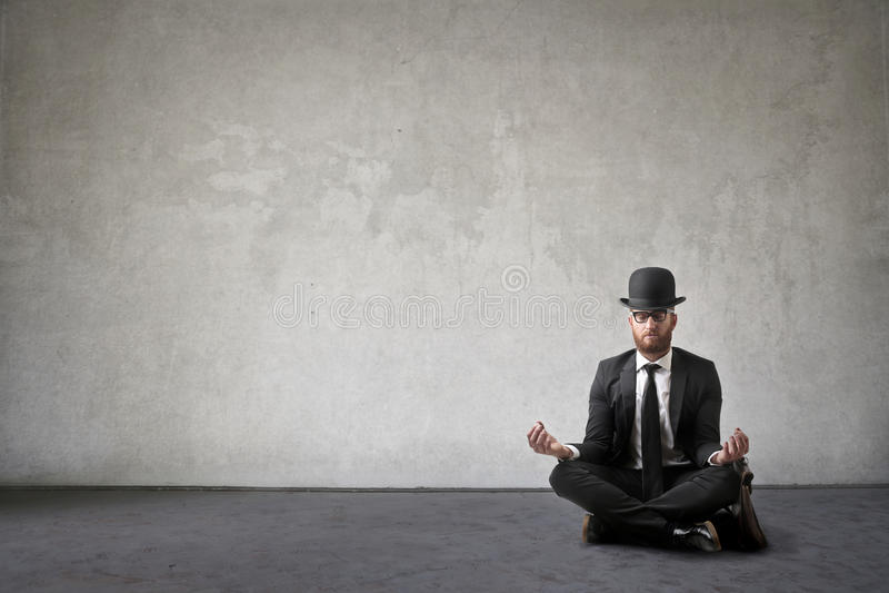Meditating business man royalty free stock image