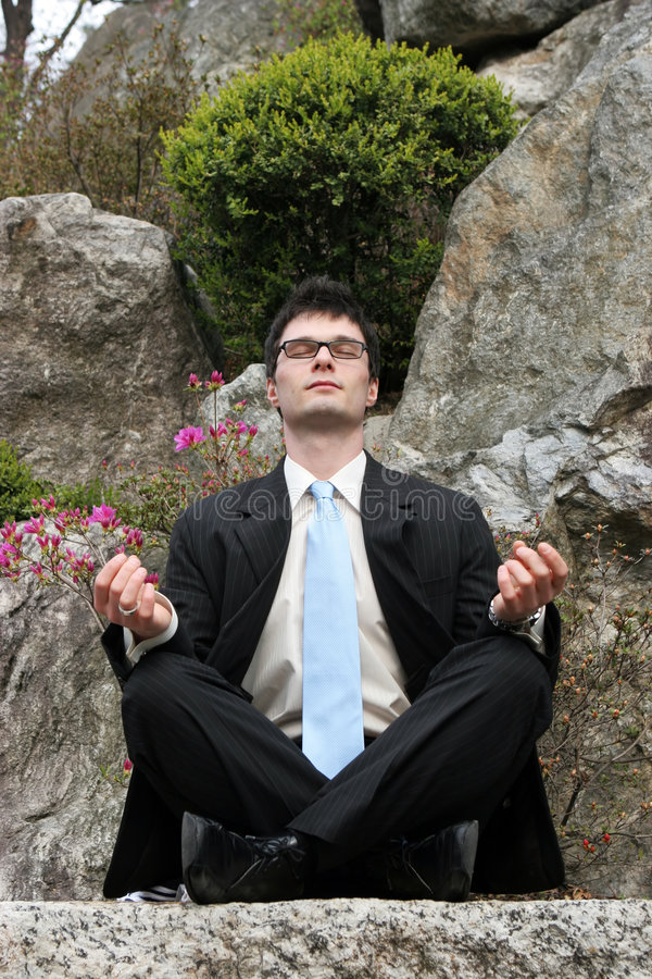Meditating businessman royalty free stock photos