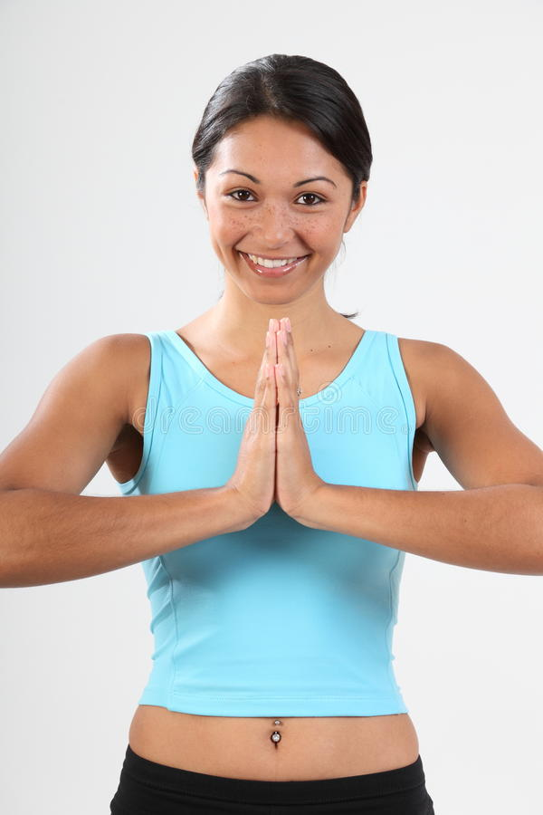 Meditating exercise by beautiful smiling woman stock photo