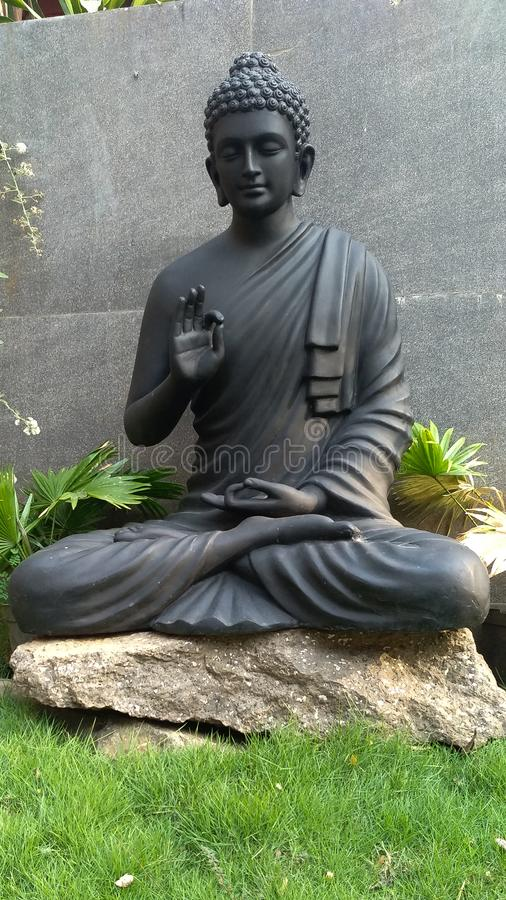 Meditating Lord Buddha on decorative pattern royalty free stock images