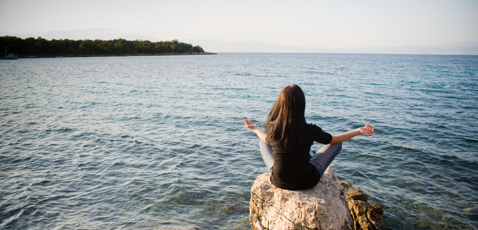 Download Meditating by the sea stock image. Image of energy, relax - 6574849