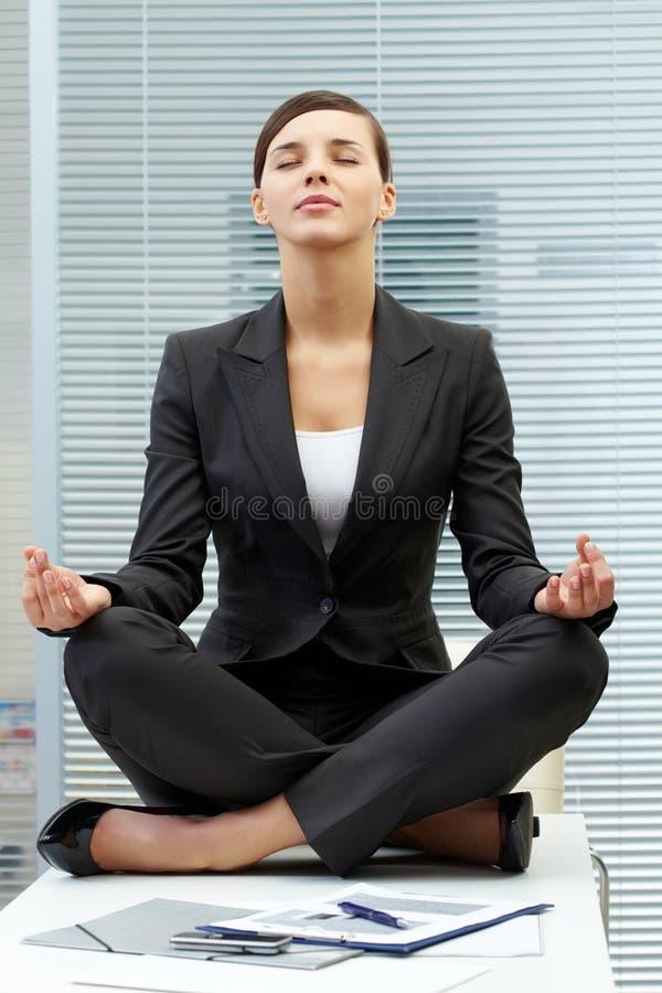 Meditating on table royalty free stock photos