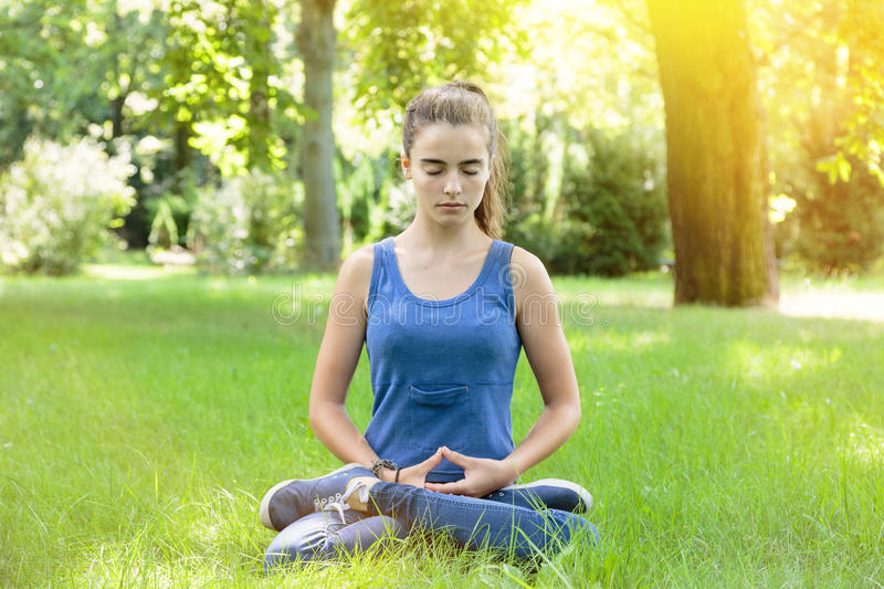 Meditating teenage girl stock photos