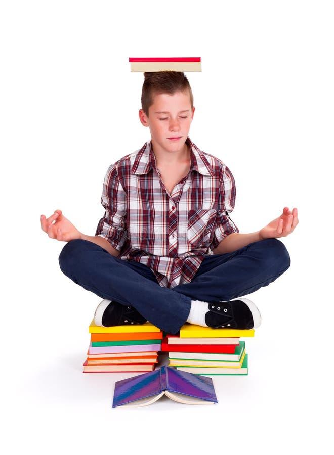 Meditating teenager stock photo