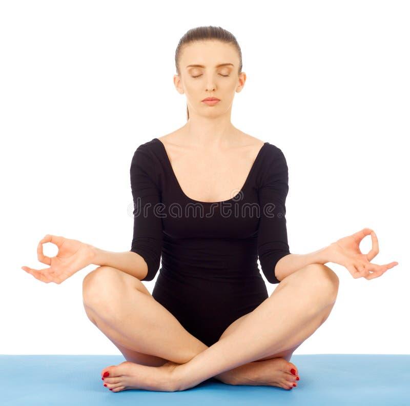 Meditating on white stock images