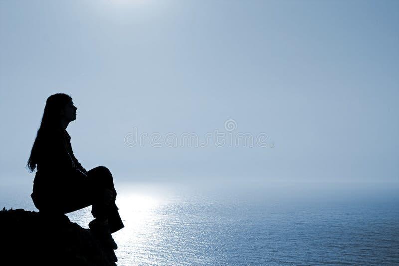 Meditating woman royalty free stock photo