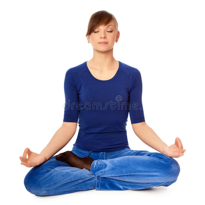 Meditating in yoga style stock images