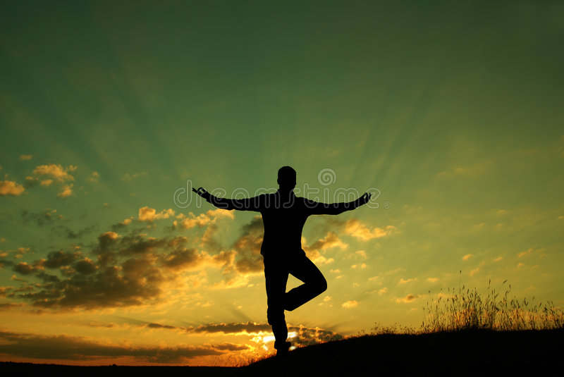 Meditation. Silhouette of a man meditating royalty free stock photos