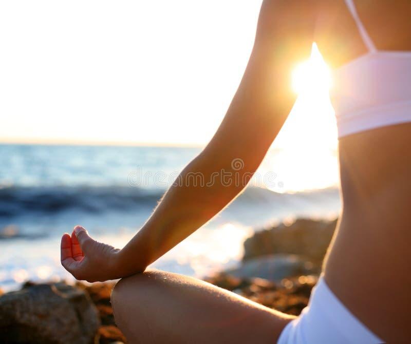 Meditation on the beach. Body of a beautiful girl in a meditation on the beach stock photos