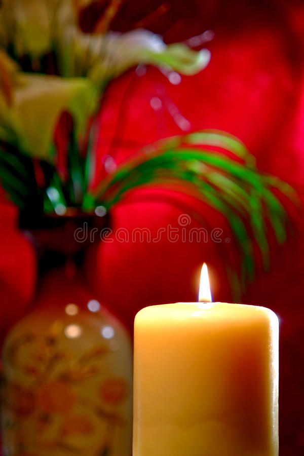 Meditation Candle in Soft Traditional Asian Decor stock photos