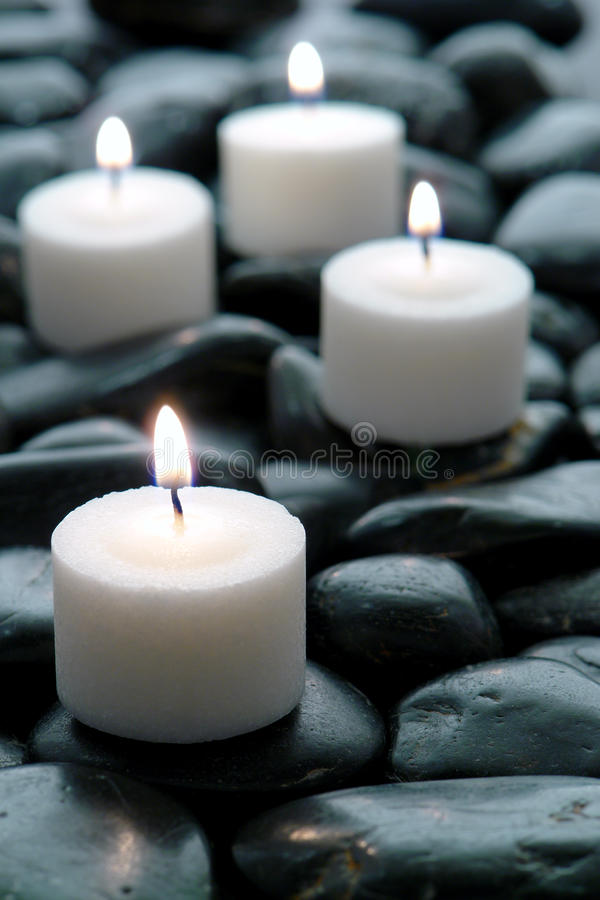 Meditation Candles Burning on Black Stone Zen Path royalty free stock images