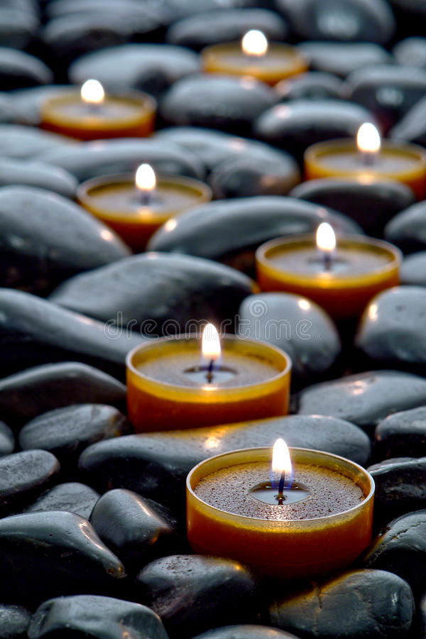 Meditation Candles Burning on Black Stone Zen Path stock photo