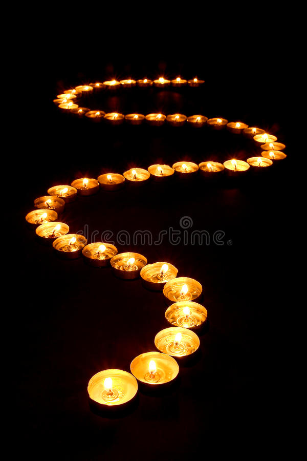 Meditation Candles Glowing in Spiritual Zen Path stock image