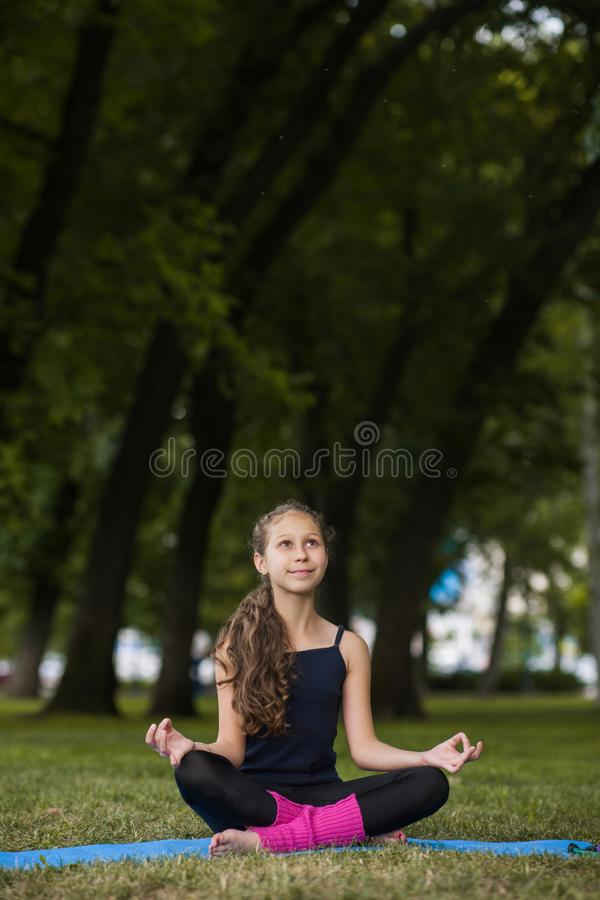 Meditation for children. Teenage yoga royalty free stock photos