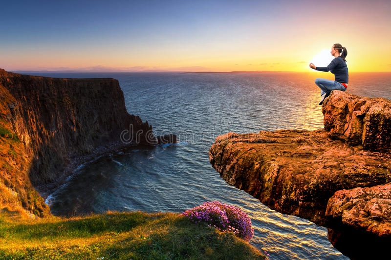 Meditation On The Edge Of A Cliff At Sunset Stock Photos