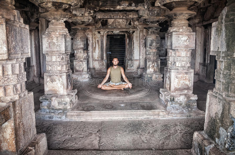 Meditation in Hampi temple royalty free stock image