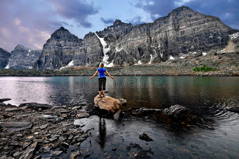 Meditation by lake in Valley of Ten Peaks. Inner peace. royalty free stock photos