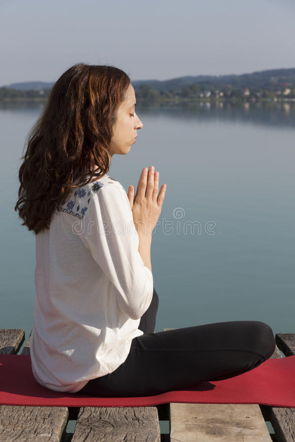Meditation by lake royalty free stock photos