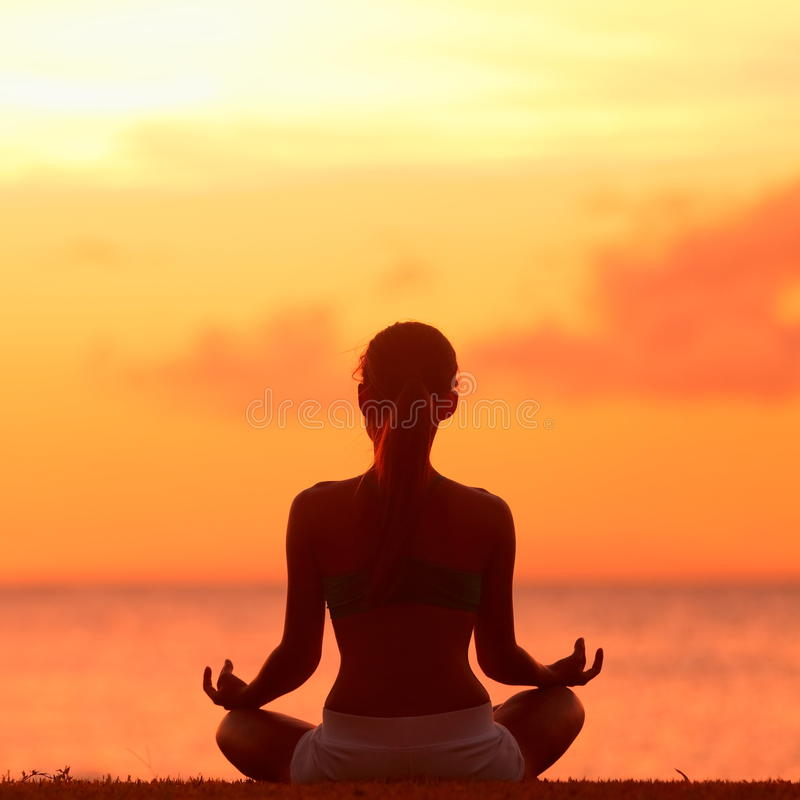 Meditating Yoga Woman At Beach Sunset Stock