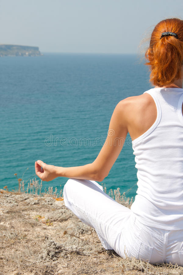 Download Meditation in mountains stock image. Image of meditating - 15814137