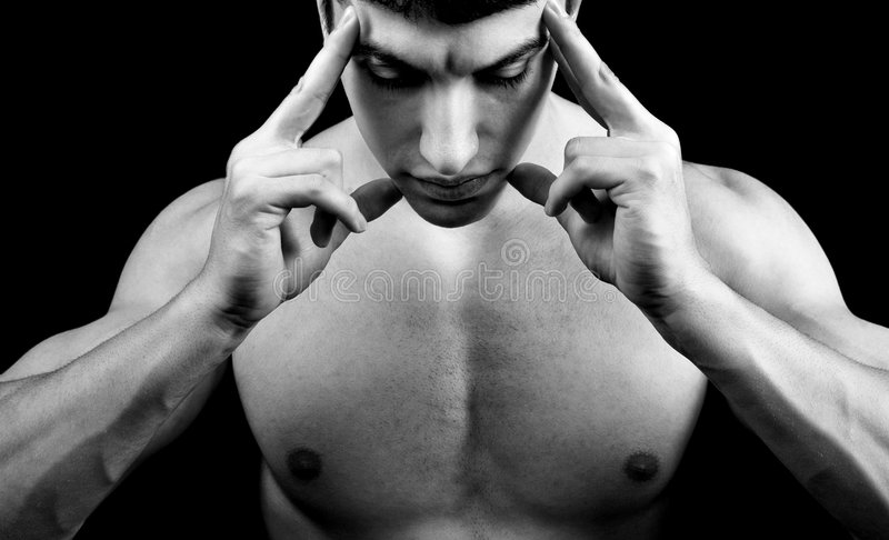 Meditation - muscular man in deep concentration stock image