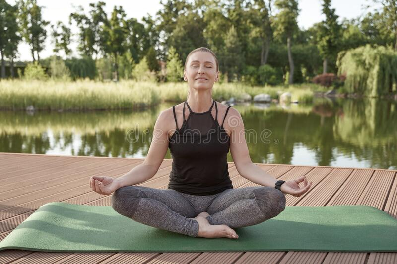 Meditation In Nature Beautiful Happy Woman In Sportswear Meditating In The Morning Sitting In Lotus Pose On A Mat With Stock Photo Image Of Forest Lotus 191338226