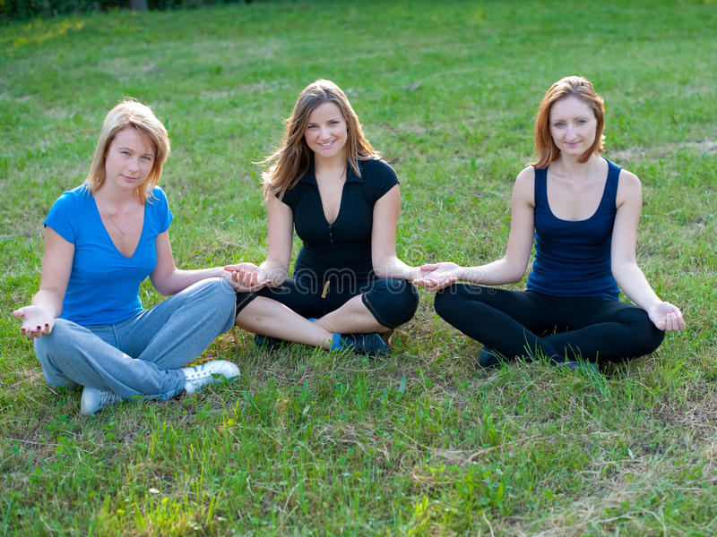 Meditation in nature of cute girls royalty free stock photography