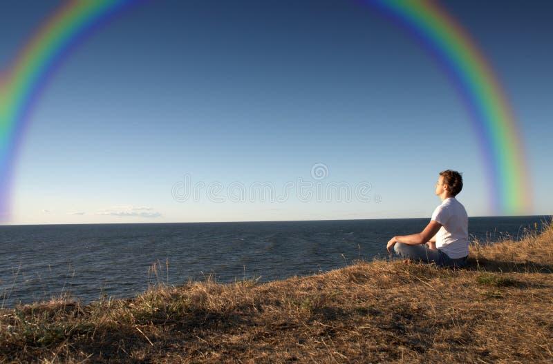 Meditation with rainbow royalty free stock photo