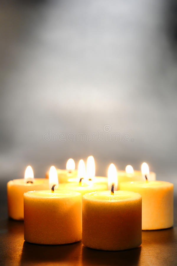 Meditation or Relaxation Votive Candles with Smoke royalty free stock photo