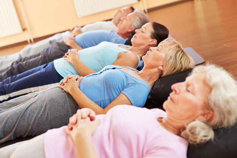 Meditation and relexation in fitness center stock images