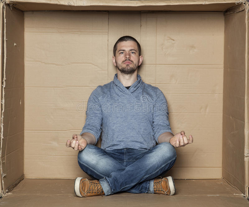 Meditation in a small room stock photo