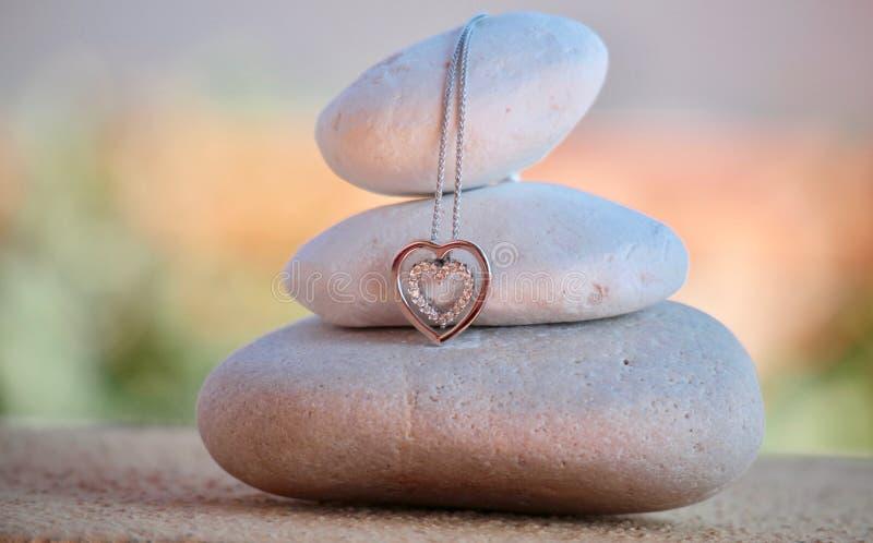 Meditation stones and heart pendant stock image