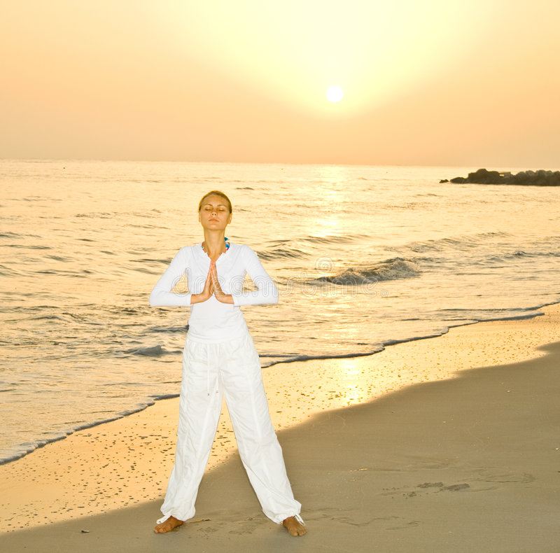 Download Meditation On A Sunrise By A Sea Royalty Free Stock Images - Image: 7046569