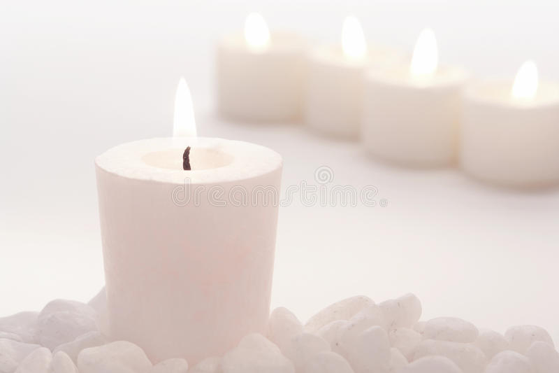 Meditation Votive Candle in High Key White Mood royalty free stock image