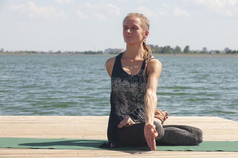 Meditation. young woman sitting in the lotus position royalty free stock photography