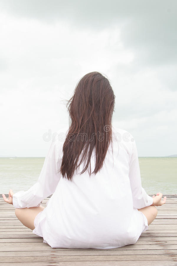 Meditation by young women royalty free stock photo