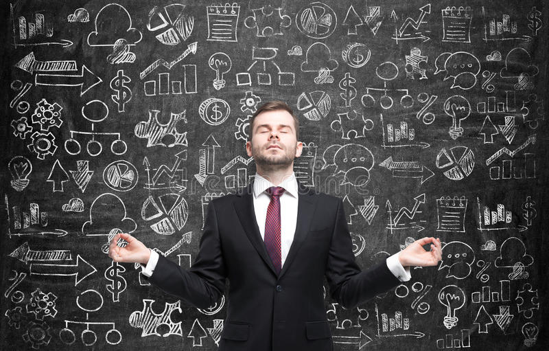 Meditative man is looking for the best solution for the business development process. Business icons are drawn over the hu royalty free stock photo