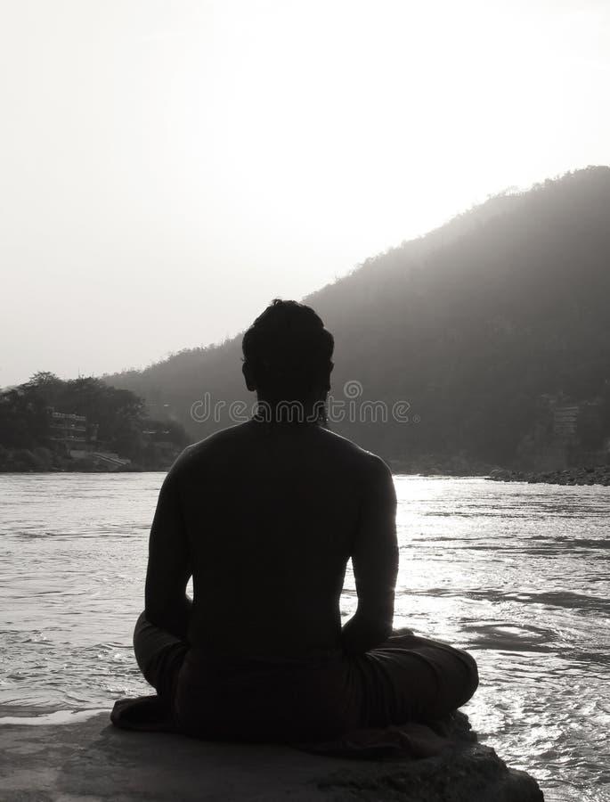 Meditative postures - Daily Retuals- Hindu Sadhu. Various meditative postures have been used in meditation. Sitting, supine lying, and standing[1] postures are stock photo