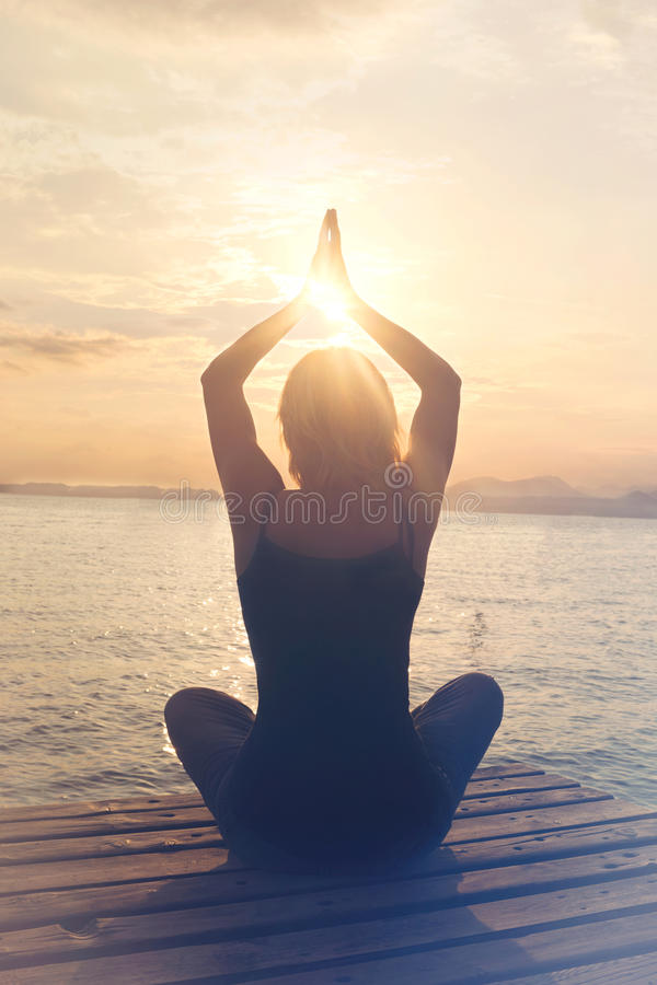 Meditative woman is in harmony with itself and the nature stock image