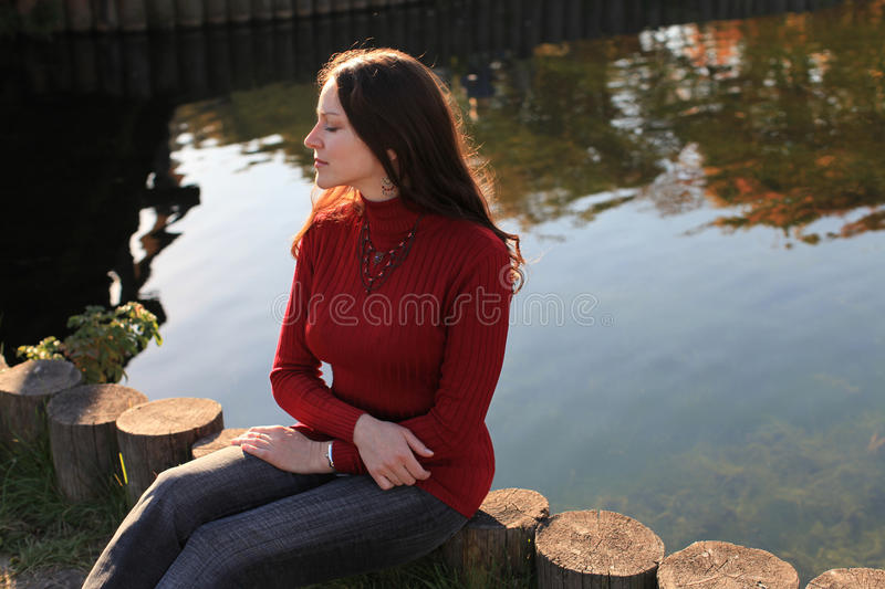 Meditative woman by lake royalty free stock images