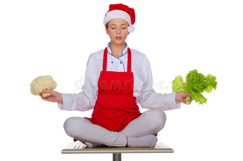 The meditator cook with vegetables stock photography