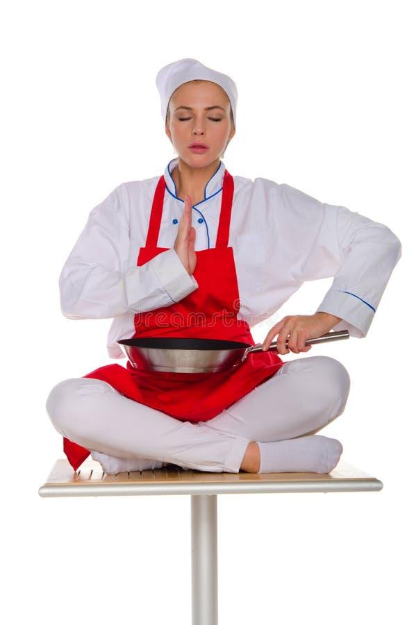 Meditatorkocken med stekpannan arkivfoton