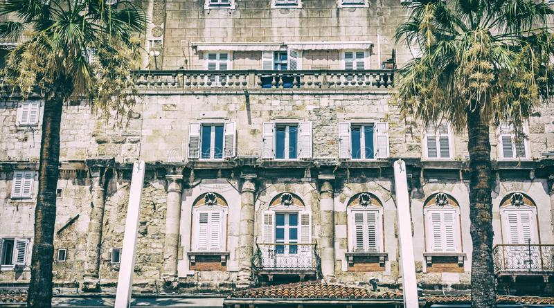 Mediterranean architecture in Split, Croatia. Architectural scene. Travel destination. Analog photo filter with scratches stock photography