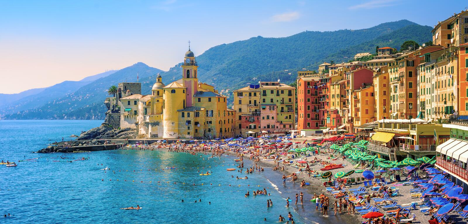 Mediterranean beach in Camogli, Liguria, Italy. Panoramic view of historical Old Town Camogli and sand beach on mediterranean coast in Camogli, italian Riviera royalty free stock images