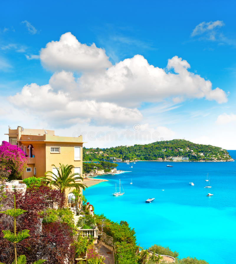 Mediterranean beach landscape, french riviera. Beautiful mediterranean beach landscape, view of luxury resort and bay of Villefranche-sur-Mer, Cote d'Azur stock images